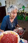 An Italian woman making tomato sauce in Noepoli, Basilicata, Italy, Europe
