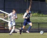 University of Rhode Island (URI) midfielder Mike Casey (18) brings the ball forward as Boston College midfielder Jason Abbott (6) closes. Boston College defeated University of Rhode Island, 4-2, at Newton Campus Field, September 25, 2012.