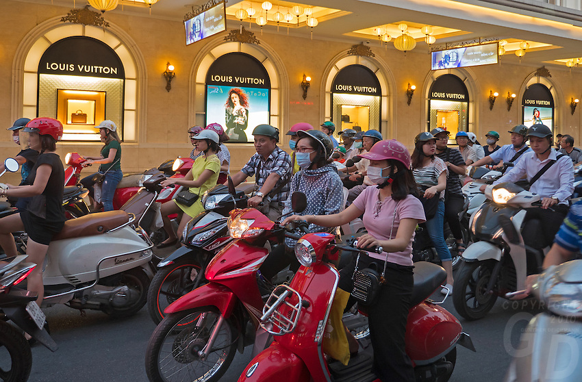 Modern fashion shops and thousands of Bikes in Hanoi, the capital of Vietnam, is known for its centuries-old architecture and a rich culture with Southeast Asian, Chinese and French influences. At its heart is the chaotic Old Quarter, where the narrow streets are roughly arranged by trade. There are many little temples, including Bach Ma, honoring a legendary horse, plus Đồng Xuân Market, selling household goods and street food.