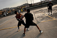 Peruvian youths practice boxing sparring at the Boxeo VMT boxing club in an outdoor gym in Lima, Peru, 2 April 2013. Boxeo VMT is a grassroots organisation offering boxing lessons to youth as an alternative to gang violence, crime and drug-trafficking. Located in some of Lima's most marginalized neighborhoods, Boxeo VMT club joins nearly 50 young men. Although the club disposes only of an unequipped outdoor facility with couple of punching bags, the young boxers train hard three times a week and dream to become a boxing champion.