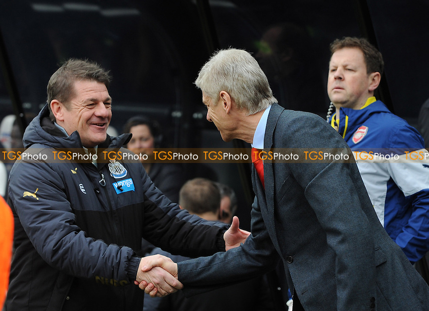 Newcastle United manager John Carver and Arsenal manager Arsène Wenger embrace before kick off - Newcastle United vs Arsenal - Barclays Premier League Football at St James Park, Newcastle upon Tyne - 21/03/15 - MANDATORY CREDIT: Steven White/TGSPHOTO - Self billing applies where appropriate - contact@tgsphoto.co.uk - NO UNPAID USE