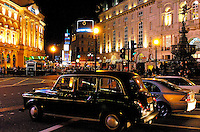 Piccadily Circus in London, England at night.