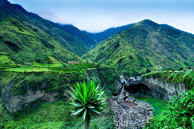Outside of Banos, Ecuador the green peaks of the Andes Mountains and its lush tropical landscapes are a gateway to the Upper Amazon Basin.