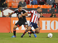 Chivas USA midfielder Peter Vagenas (6) goes against D.C. United midfielder Nick DeLeon (18) D.C. United defeated Chivas USA 1-0 at RFK Stadium, Sunday September 23, 2012.