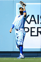 4 May 2011: Centerfielder Matt Kemp looks into the sun through is sunglasses before making a catch of a fly ball. The Cubs defeated the Dodgers 5-1 during a Major League Baseball game at Dodger Stadium in Los Angeles, California.  Dodgers players are wearing Brooklyn Dodger 1940's throwback jersey uniforms and the Chicago Cubs are also wearing throwback retro jersey uniforms. **Editorial Use Only**