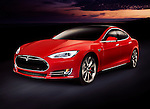 Red 2014 Tesla Model S luxury electric car outdoors on tthe road at night