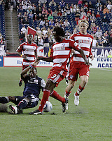 New England Revolution midfielder Sainey Nyassi (14) slides to prevent a pass by FC Dallas defender Ugo Ihemelu(3).  The New England Revolution drew FC Dallas 1-1, at Gillette Stadium on May 1, 2010