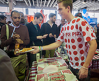 The Push For Pizza app developers offer free pizza at the TechDay New York event on Thursday, April 23, 2015. Thousands attended to seek jobs with the startups and to network with their peers. TechDay bills itself as the world's largest startup event with over 300 exhibitors. (© Richard B. Levine)