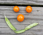 Fresh tomatoes and peas form a smile