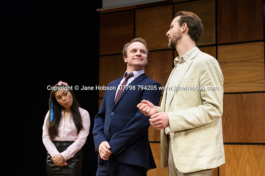 """London, UK. 22.03.2017. """"CHINGLISH, by David Henry Hwang, opens at the Park Theatre. Directed by Andrew Keates, with lighting design by Christopher Nairne and set and costume design by Tim McQuillen-Wright. Picture shows:  Siu-See Hung (Qian), Gyuri Sarossy (Daniel), Duncan Hart (Peter Timms). Photograph © Jane Hobson."""