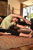 Women in Home Doing Yoga