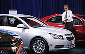 United States President Barack Obama looks at a Chevrolet Malibu during a visit to the DC Auto Show at the Walter E. Washington Convention Center in Washington, DC on January 31, 2012. .Credit: Olivier Douliery / Pool via CNP