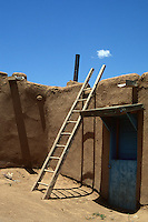 Remains of an adobe building with a ladder in New Mexico
