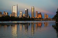 Beautiful Sunset  falls on the Austin Skyline as water enthusiast kayak and canoe on Lake Austin