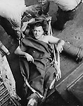 An injured crewman of the USS Minneapolis is tended to after an attack while anchored at Tulagi the day after the Battle of Lunga Point, Guadalcanal.