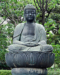 Japanese Buddha statue sitting on lotus blossom