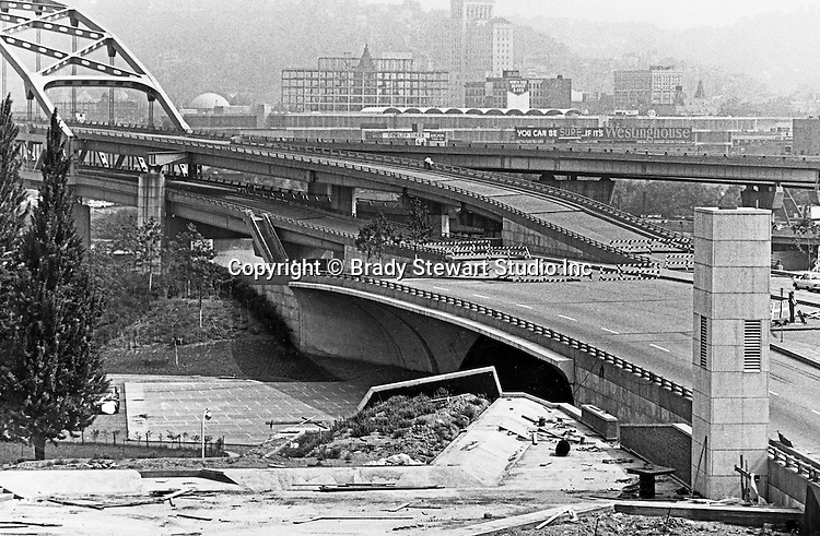 "Pittsburgh PA:  View of the construction of the Fort Duquesne bridge ramps - 1966.  The construction of the bridge to nowhere started in 1958 and almost completed in 1963.  The bridge was open to traffic in 1969.  The construction of the Allegheny Center Mall is in the background along with the ""You can be SURE it's Westinghouse"" sign."
