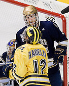 Ryan Thang (Notre Dame - 9), Carl Hagelin (Michigan - 12) - The University of Notre Dame Fighting Irish defeated the University of Michigan Wolverines 5-4 in overtime in their 2008 Frozen Four Semi-Final matchup on Thursday, April 10, 2008, at the Pepsi Center in Denver.