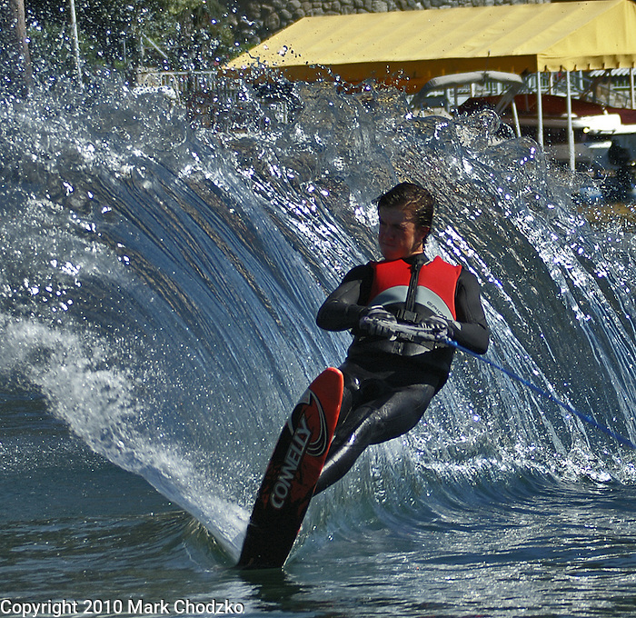 Water skiing with a big water sprying