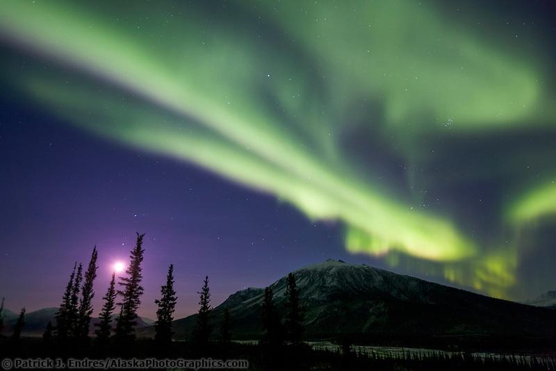 Moon and Aurora borealis over the Brooks mountain range, Arctic, Alaska.