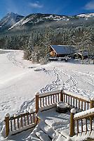 Snow Covered Log Cabin at Chilko Lake and Ts'yl-os Provincial Park, Cariboo Chilcotin Coast Region, BC,  British Columbia, Canada - Winter