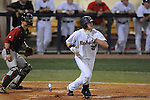 Ole Miss' Matt Tracy (29) bats against Alabama at Oxford-University Stadium in Oxford, Miss. on Friday, March 18, 2011. Ole Miss won 4-0. The Rebels are 15-4 on the season and 1-0 in SEC play.  (AP Photo/Oxford Eagle, Bruce Newman)