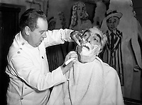 Mr Noel Purcell having his beard removed for Pantomime - Special for Radio Review.23/12/1955..Noel Purcell (23 December 1900 - 3 March 1985) was an Irish film and television actor...Purcell began his show business career at the age of 12 in Dublin's Gaiety Theatre. Later, he toured Ireland in a vaudeville act with Jimmy O'Dea..Stage-trained in the classics in Dublin, Purcell moved into films in 1934. He appeared in Captain Boycott (1947) and as the elderly sailor whose death marooned the lovers-to-be in the first sound film version of The Blue Lagoon (1949). Purcell played a member of Captain Ahab's crew in Moby Dick (1956), a gameskeeper in The List of Adrian Messenger (1963), and a barman in The Mackintosh Man (1973), all films directed by John Huston..In 1955, he was an off-and-on regular on the British filmed TV series The Buccaneers (released to American TV in 1956), and Purcell narrated a Hibernian documentary, Seven Wonders of Ireland (1959). In 1962, he portrayed the lusty William McCoy in Lewis Milestone's Mutiny on the Bounty. .Purcell also gained some recognition as a singer. Shortly after World War II, songwriter Leo Maguire composed &quot;The Dublin Saunter&quot; for him. He performed the song live for many years and later recorded it for the Glenside label. However, the recording was not a hit. As Purcell recalled many years later, &quot;I don't think one person in the world bought it.&quot; In 1981, he recorded a spoken word version of Pete St. John's &quot;Dublin in the Rare Old Times&quot;..In June 1984, Purcell was given the Freedom of the City of Dublin. Nine months later, he died in his native city at the age of 84..