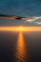 A view of the setting sun as seen from an inter-island flight near O'ahu, Hawai'i.