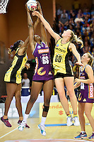 Katrina Grant ( Pulse ) and Romelda Aiken ( Firebirds ) in action during the ANZ Championship - Mojo Pulse v Queensland Firebirds at Te Rauparaha Arena, Porirua, New Zealand on Sunday 8 March 2015. <br /> Photo by Masanori Udagawa. <br /> www.photowellington.photoshelter.com.
