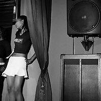 A contestant in Miss Rockafella's Beauty Competition being held in a pub on Rockey Street, Yeoville.