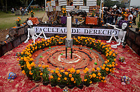 A candle is seen at Autonomous University of Mexico while they  celebrate the day of the dead in honor  to the 50 anniversary of the death of the Spanish-Mexican surrealist painter Remedios Varo, October 25, 2013. Photo by Miguel Angel Pantaleon/VIEWpress