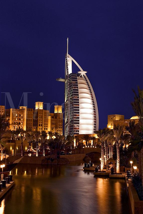 Dubai, United Arab Emirates. Madinat Jumeirah. Burj al Arab Hotel, &amp;#xD;Mina A'Salam Hotel and Convention Centre. Souk. Evening.&amp;#xD;<br />