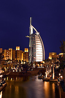 Dubai, United Arab Emirates. Madinat Jumeirah. Burj al Arab Hotel, &amp;#xD;Mina A'Salam Hotel and Convention Centre. Souk. Evening.&amp;#xD;<br />