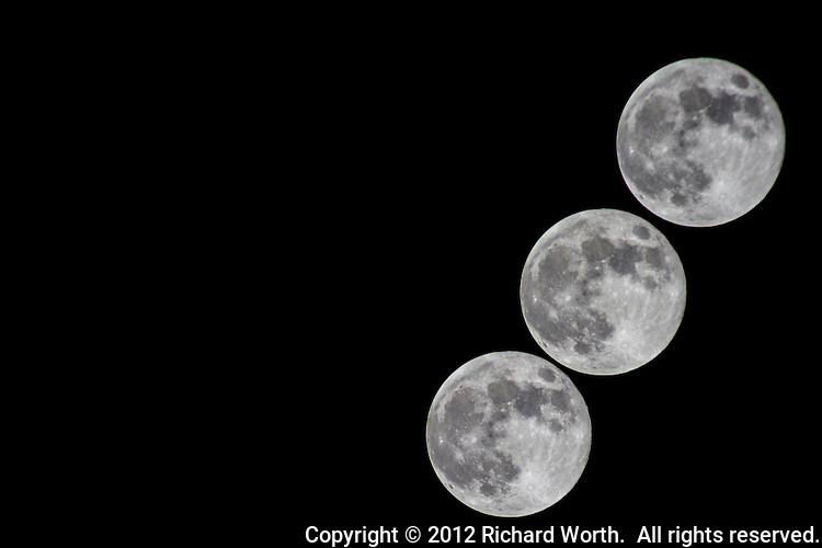 A time-lapse sequence of three images as the Full Hunter's Moon crossed the sky above the yard, my yard - October 29, 2012