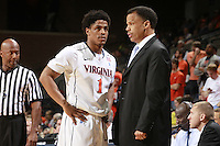CHARLOTTESVILLE, VA- NOVEMBER 26:  Jontel Evans #1 of the Virginia Cavaliers talks with associate head coach Ritchie McKay during the game on November 26, 2011 at the John Paul Jones Arena in Charlottesville, Virginia. Virginia defeated Green Bay 68-42. (Photo by Andrew Shurtleff/Getty Images) *** Local Caption *** Jontel Evans;Ritchie Mckay