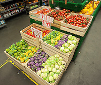 Colored baby cauliflower and other produce in a grocery store in New York on Monday, June 27, 2016. (© Richard B. Levine)