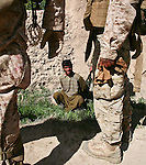 A young Afghan farmer is held briefly for questioning by Marines from Company L, 3rd Battalion, 6th Marine Regiment, after a Taliban attack near Marjah, Afghanistan. The farmer said he saw three men running away after the attack, but the Marines decided not to go after them. &quot;There's really nothing to be gained by chasing three guys who may or may not be Taliban and who are 800 meters away, &quot; said 1st Lt. Carl Quist, 30, of Annandale, Va.  The farmer was let go, and the Marines returned to their patrol base an hour's march away. March 10, 2010. DREW BROWN/STARS AND STRIPES