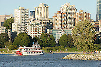 Old fashioned paddleboat or sternwheeler sightseeing boat with skyline, Vancouver, British Columbia, Canada                 .