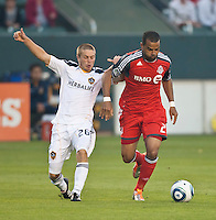 CARSON, CA – June 11, 2011: Toronto FC forward Maicon Santos (29) and LA Galaxy midfielder Michael Stephens (26) during the match between LA Galaxy and Toronto FC at the Home Depot Center in Carson, California. Final score LA Galaxy 2, Toronto FC 2.
