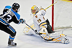 30 October 2010: University of Vermont Catamount goaltender Rob Madore, a Junior from  Pittsburgh, PA, gives up the game winning goal to University of Maine Black Bears forward Spencer Abbott at Gutterson Fieldhouse in Burlington, Vermont. The Black Bears defeated the Catamounts 3-2 in sudden death overtime. Mandatory Credit: Ed Wolfstein Photo