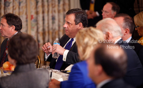 Governor Chris Christie of New Jersey listens to United States President Barack Obama's remarks to the National Governors Association in the State Dining Room of the White House in Washington, D.C. on February 25, 2013.  .Credit: Dennis Brack / Pool via CNP