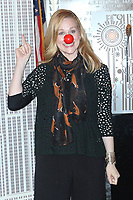 MAY 25 Laura Linney and Lucia Moniz light the Empire State Building in honor of Red Nose Day