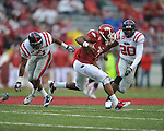 Arkansas running back Knile Davis (7) is tackled by Ole Miss safety Johnny Brown (20) at Reynolds Razorback Stadium in Fayetteville, Ark. on Saturday, October 23, 2010.