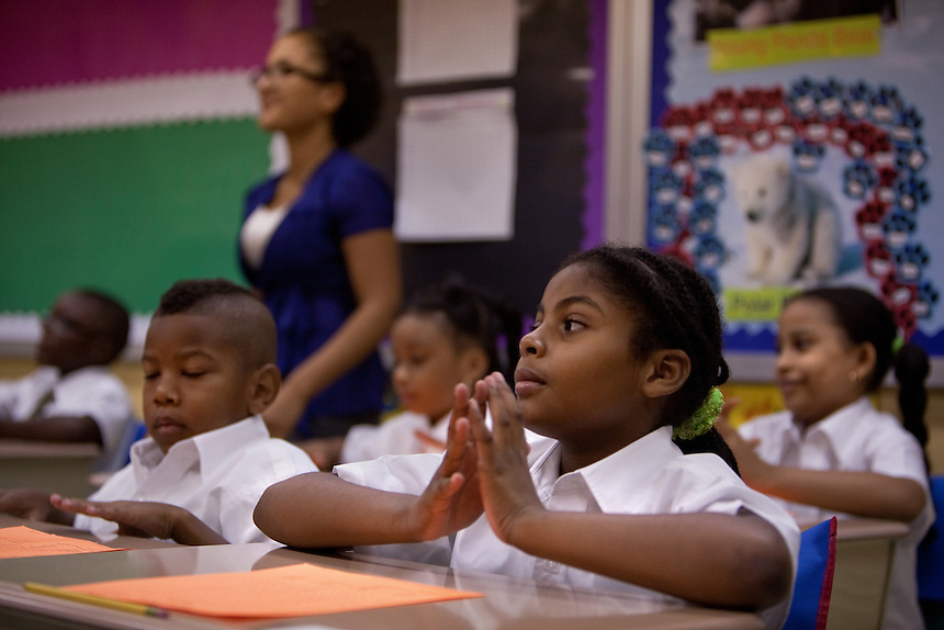 Third-grade co-teacher Rosanna Reyes watches over the class Students on the first day of class at Brownsville Elementary School in Brooklyn, NY on August 15, 2011.