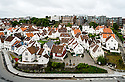 Old white clapboard houses in the older part of Stavanger, Norway.