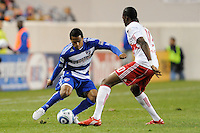 David Ferreira (10) of FC Dallas is marked by Macoumba Kandji (10) of the New York Red Bulls. The New York Red Bulls defeated FC Dallas 2-1 during a Major League Soccer (MLS) match at Red Bull Arena in Harrison, NJ, on April 17, 2010.