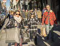 Shoppers on Broadway in the Soho neighborhood of New York on Sunday, December 4, 2016. Only three weeks to Christmas. (© Richard B. Levine)
