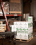 June 18, 2013. Chapel Hill, North Carolina<br />  Cases of TOPO Gin await pickup for shipping.<br />  TOPO, Top of the Hill Distillery, the brainchild of owner Scott Maitland and Spirit Guide Esteban McMahan, is located in the old N&amp;O Building on Franklin Street. Making gin, vodka and American whiskey from locally sourced wheat, they are one of the few distilleries bringing  organic liquor to ABC shelves around the state.