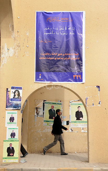 SULAIMANIYAH, IRAQ:  A man walks into the market where the walls are already covered with posters on the first day of official election campaigning...Election workers start their campaigns for the Iraqi Parliamentary Elections due to be held March 7th, 2010...Photo by Pazhar Muhammed/Metrography