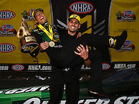 Feb 28, 2016; Chandler, AZ, USA; NHRA top fuel driver Leah Pritchett celebrates with husband Gary Pritchett after winning the Carquest Nationals at Wild Horse Pass Motorsports Park. Mandatory Credit: Mark J. Rebilas-